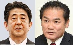 安倍首相(左)と佐喜真市長