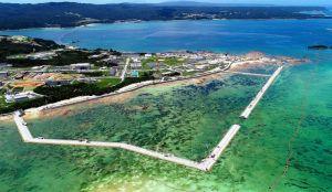 新基地建設が進むキャンプ・シュワブ沿岸。海域を護岸で囲む工事が進み、7月中に中央右側の「K4」護岸をつなげる見通し=6月29日、名護市辺野古の米軍キャンプ・シュワブ(小型無人機で撮影)