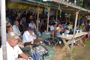 大雨の中、市民ら約80人が新基地建設に反対の声を上げた=12日午前11時ごろ、名護市辺野古の米軍キャンプ・シュワブゲート前