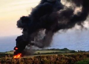 米軍ヘリが墜落したとみられる現場=11日午後6時前、東村高江(提供)